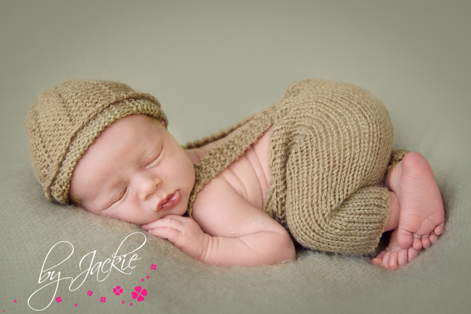 Newborn baby boy in bottom up pose by Babies By Jackie near York and Leeds UK