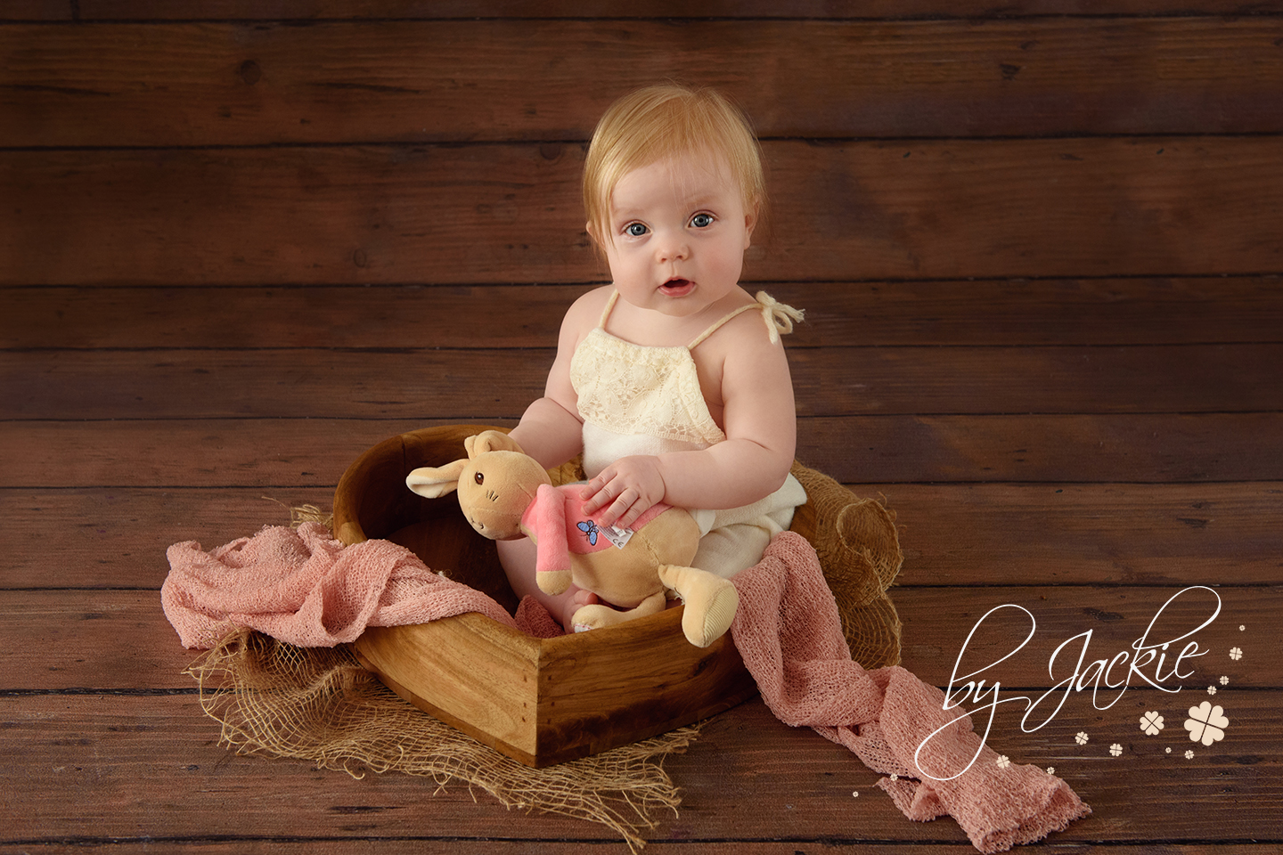 Image of 8 month old baby girl sitting in heart bowl by Babies By Jackie Photography near Howden, York, Goole and Beverley