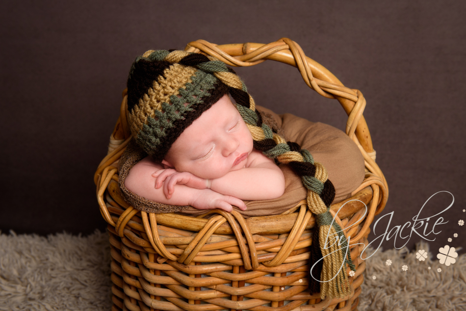 Photograph of newborn baby boy asleep in a basket. Image by Babies By Jackie in Market Weighton, near Beverley, Pocklington and York.