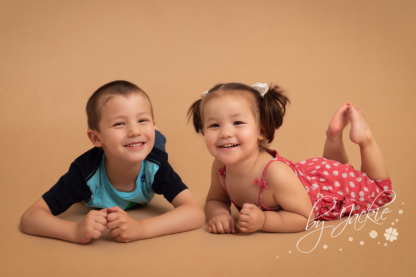 Little boy and girl laughing at family portrait photo shoot with babies By Jackie Photography in Market Weighton, York, North Yorkshire near Pocklington, Beverley, Asselby, Hessle and Hull