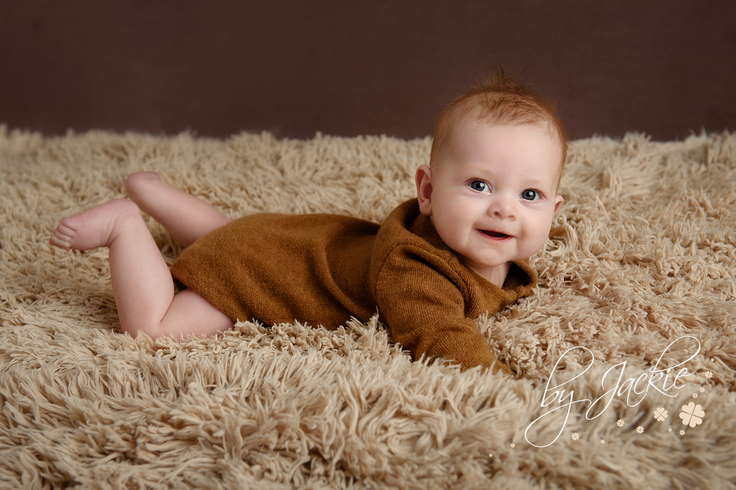 4 month old baby boy on his tummy for tummy milestone session with Babies By Jackie Photography in Market Weighton, near York, Pocklington, Asselby, Hessle and Hull, Yorkshire UK