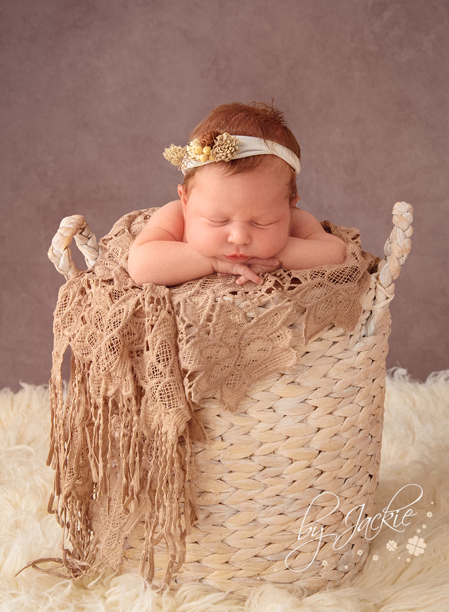 Newborn baby girl asleep in basket. Photographed by Babies By Jackie, Market Weighton, Yorkshire UK