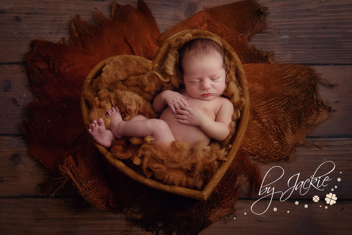 Newborn baby boy asleep in heart bowl by Babies By Jackie professional baby photographer in Market Weighton, York, North Yorkshire, UK