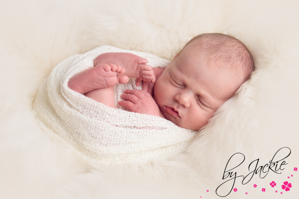 Image of newborn baby wrapped in cream by Babies By Jackie, Howden, York and Leeds