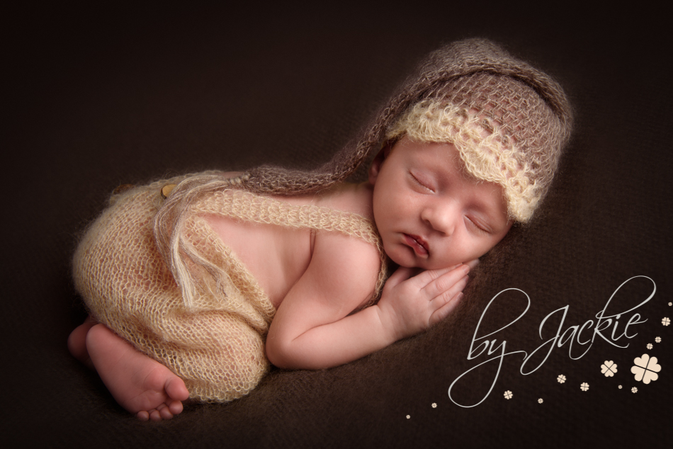 Photograph of newborn baby boy in sleepy hat by Babies By Jackie in Market Weighton, near York, Hull and Asselby