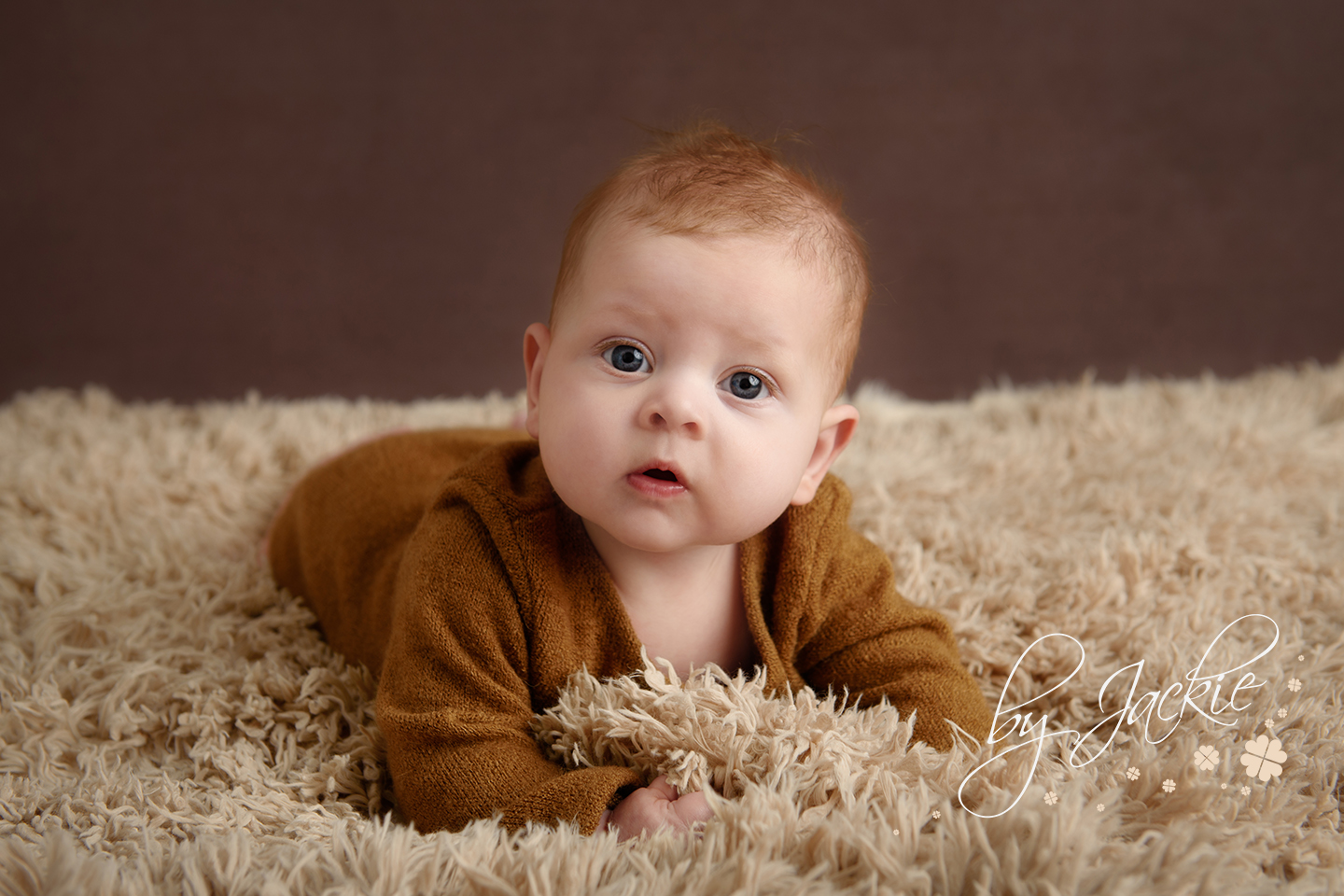 Photo of four month old baby boy. Sitter sessions with Babies By Jackie Photography, Market Weighton near York, Selby, Howden, Hull and Beverley, Yorkshire, East Ridings, UK