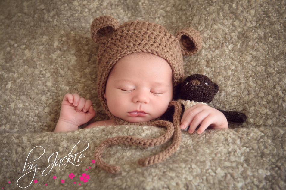 Baby boy snuggled in bed with teddy Image Babies By Jackie Photography Howden, Beverley, Hull UK