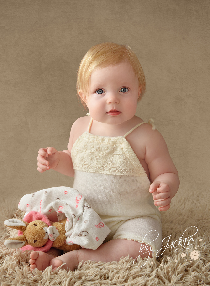 Eight 8 month old baby girl photographed by Babies By Jackie Photography in Market Weighton, North Yorkshire, near to Pocklington, York, Beverley, Driffield, Asselby, Hessle and Hull, East Ridings, UK