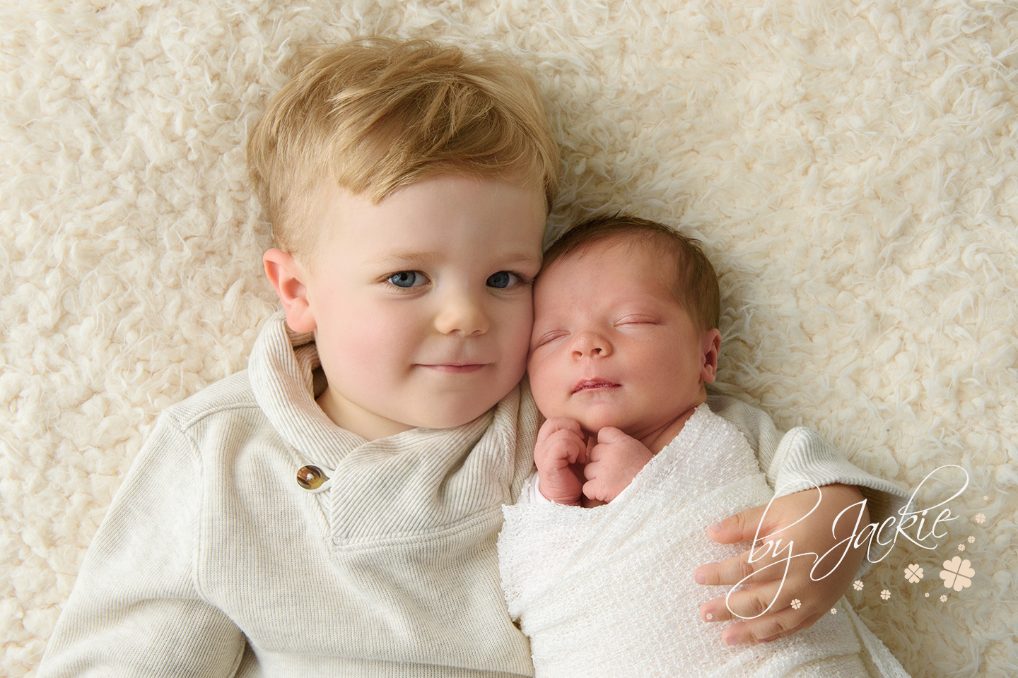 Photograph of little boy with his brand new baby sister. Sibling and newborn images by Babies By Jackie, Market Weighton, near York, Pocklington, Beverley, Hull, Hessle, Asselby and Howden. Yorkshire baby photographer