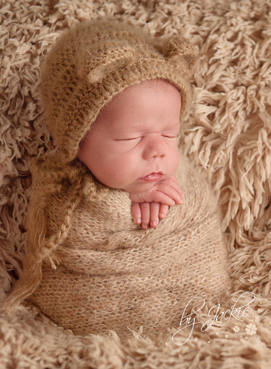 Image of newborn baby boy wrapped in potato sack pose by Babies By Jackie Photography. Studio in Market Weighton, near Pocklington, Beverley, Asselby, Hessle and Hull. Yorkshire UK