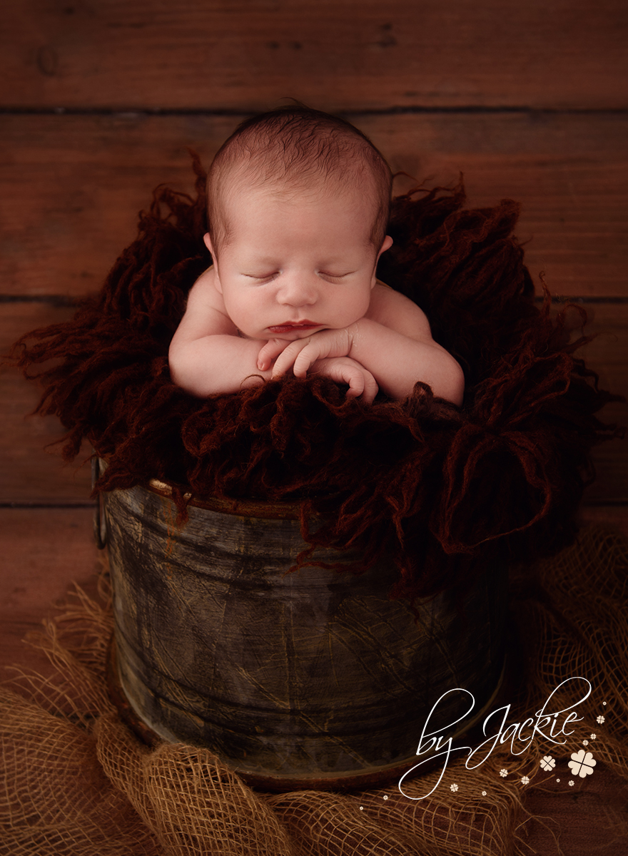Image of a newborn baby boy in a bucket by Babies By Jackie in Market Weighton, near York, Pocklington, Beverley and Hessle in Yorkshire, UK
