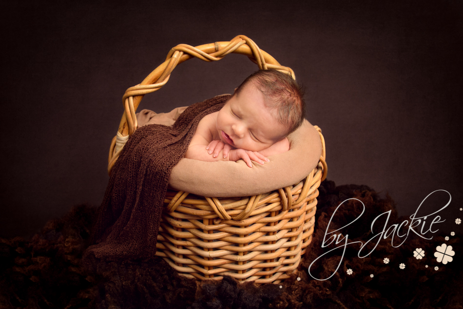 Photograph of newborn baby in a basket. Image copyright Babies By Jackie Photography, Hemingbrough, York and Howden