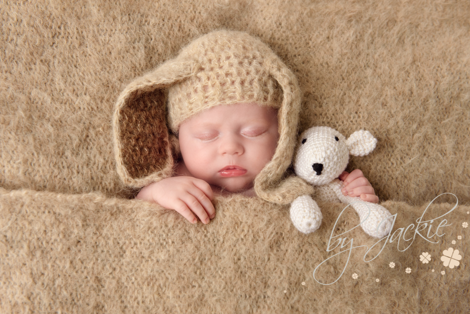 Photo of newborn baby boy with rabbit hat and hand made keepsake teddy photo