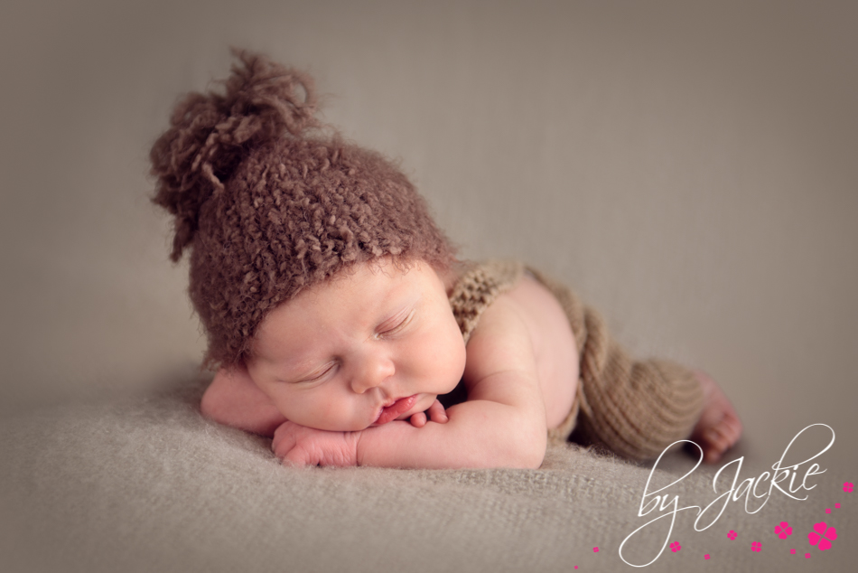 Photography of newborn baby boy in bobble hat. Image by Babies By Jackie, near York, Howden, Goole and East Ridings