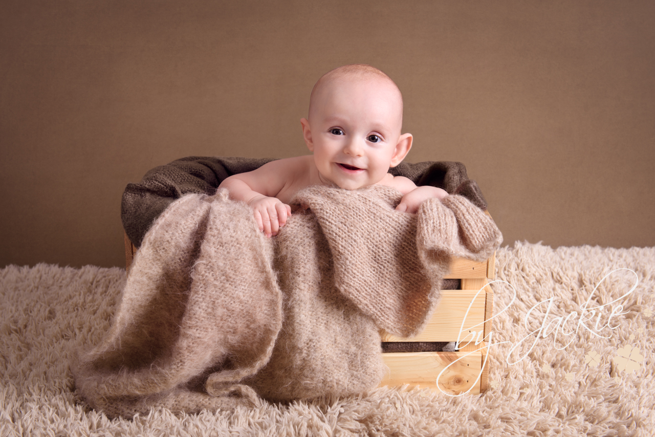 Photo of 4 month old baby, sat in a basket. Photo By Jackie Photography in Selby, Yorkshire, UK