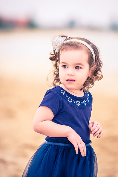 The beach at sunset for this beautiful little girl